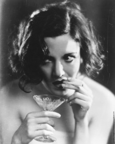 A true lady knows how to hold a cocktail glass.